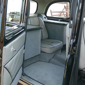 The rear passenger seat (now a single due to the wheel tubs but it still has the two pull down taxi seats as well