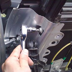 Front top screw Again behind the rubber (shown with the rubber removed